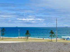 Big blue ocean (sander_sloots) Tags: indian ocean scarborough beach perth sea indische oceaan lampposts strand lantaarnpalen trees norfolk island pines bomen dctz90 lumix panasonic zee streetlights clouds wolken water blue blauw ships schepen