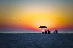 Sticking around until the very end. (Notkalvin) Tags: sunset clearwater beach florida usa umbrella end shore sand relax colorful summer mikekline notkalvin outdoors nature beauty beautiful serene relaxation betterthansnow
