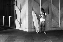 city to surf (gro57074@bigpond.net.au) Tags: stphotographia pbwa man surfboard surfer candidportrait candidstreet candid f71 2470mmf28 tamron d850 nikon monochromatic monotone monochrome mono bw blackwhite pittstreet cbd sydney january2020 guyclift citytosurf streetphotography street