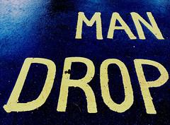 Man Drop (Rhisiart Hincks) Tags: wales cymru ceredigion aberystwyth words geiriau wet gwlyb yellow blue melyn glas mandrop