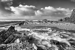 Rush to the sea...(Explored) (northdevonfocus) Tags: seascape northdevoncoast nature northdevon longexposure beach rockformations blackandwhitephotography monochrome blackandwhite black white