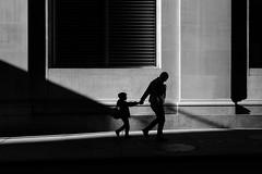 Hold Tight (Kenneth Laurence Neal) Tags: newyorkcity cities urban people street streetphotography streetphoto blackandwhite blackdiamond monochrome monotone nikond7100 nikon shadows contrast buildings silhouette