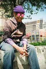 Shades of Purple (Gabriella Ollandini) Tags: man 35mm film filmphtography guy purple sunglasses sunny bright candid istillshootfilm filmisnotdead filmcamera filmnegative city urban sitting mirrored analog analogica analogue colorful portrait nyc brooklyn usa streetphotography street hands