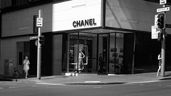 On the Corner (McLovin 2.0) Tags: urban city street streetphotography chanel sydney australia summer shadows reflection shop window monochrome bw people sony a7s 55mm zeiss