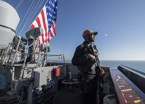 A Sailor stands watch on the port bridge wing aboard USS Carney (DDG 64), Jan. 7, 2020.