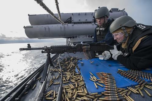 A Sailor fires an M240 machine gun during a crew served weapons qualification aboard USS Carney (DDG 64), Jan. 11, 2020.