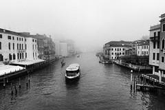 misty Venice (Francis Mansell) Tags: venezia venice water mist fog building architecture boat vehicle vaporetto waterbus canal canalgrande grandcanal pontedegliscalzi monochrome blackwhite niksilverefexpro2 gondola