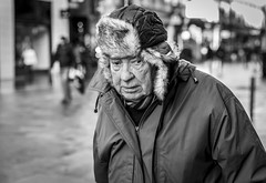 Fur Lining (Leanne Boulton) Tags: urban street candid portrait portraiture closeup streetphotography candidstreetphotography candidportrait streetportrait eyecontact candideyecontact streetlife old elderly man male face eyes expression mood emotion feeling fragile vulnerability sadness fur lining hood cold winter weather tone texture detail depthoffield bokeh naturallight outdoor light shade city scene human life living humanity society culture lifestyle people canon canon5dmkiii 70mm ef2470mmf28liiusm black white blackwhite bw mono blackandwhite monochrome glasgow scotland uk