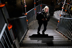 Young woman in staircase (A.Johansson) Tags: streetphotography street stockholm streetsofmine staircase candid candidphotography colorstreetphotography fuji fujifilm fujifilmxt10 facialexpression 18mm primelens shadow blonde orange provisionalstaircase winter slussen