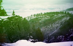 The Mountains Will Melt (Crusty Da Klown) Tags: canada britishcolumbia bc landscape wilderness trees clouds snow rocks cliffs view scenery forest outside outdoors film canon mountains melt verse hike