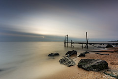 Waiting for the Summer I (Johan Konz) Tags: sunrise water lake sea waterscape clouds sun pier jetty stone sand beach landscape outdoors nopeople volendam netherlands nikon d7500 le longexposure