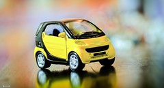 Yellow Smart - 7978 (✵ΨᗩSᗰIᘉᗴ HᗴᘉS✵90 000 000 THXS) Tags: yellow smart car voiture miniature mini bokeh belgium europa aaa namuroise look photo friends be yasminehens interest eu fr party greatphotographers lanamuroise flickering challenge