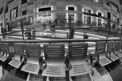 stairs and chairs (giorgioGH) Tags: stazionecentrale milano milanocentralstation chairs stairs stairway empty blackandwhite architecture architettura fisheye tapisroulant tappetomobile people street streetphotography