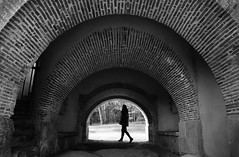 (cherco) Tags: woman alone architecture arch arquitectura walk silhouette solitary blackandwhite composition canon city composicion lonely light repetition monochrome tunnel