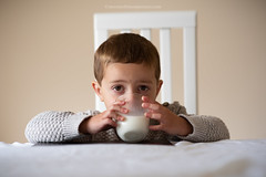 The White Stuff (Steven Robinson Pictures) Tags: milk boy browneyes cute home table scottish glass drinking thirst child innocence nikon85mmf14d portrait environmentalportrait chair culture