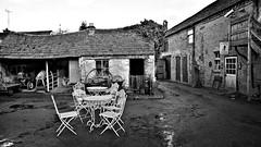 The Farmer's Den (Matt West) Tags: farm farmyard tearooms vitange blackandwhite monochrome wet muddy mud tables chairs rustic countryside country rural