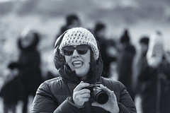 Happy photographer (Frank Fullard) Tags: frankfullard fullard candid street portrait photographer happy smile shades cap wind warm cold chilly dugort doogort achill island rnli lifeboat swim fundraiser black white blanc noir monochrome mayo atlantic sea beach strand irish ireland sony canon