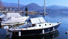 Pepita Blue (ornella sartore) Tags: lago barche inverno panorama montagne molo allaperto canon