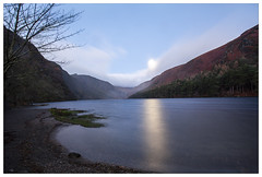 Moonset at Glendalough (Ashley Lowry) Tags: beach clouds colour dawn daybreak dark east foliage green gold grass glow golden horizon horizonoverwater h ireland irish island image illuminated jan january light landscape longexposure lights lake leaves landscapes lines landmark land morning misty mountains mist night nature naturallight outdoor outdoors outside overcast pretty reflections reflection rocks river rock sky sunrise sun sunup sunshine sunlight sunny trees tree view viewing water wet waves wicklow winter wild woods waterfall weather weed wildflowers z