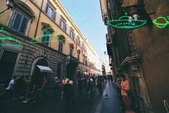 Roma (UFO) (goodfella2459) Tags: nikonf4 afnikkor14mmf28dlens konoufo200 35mm c41 film analog colour city street road italy roma rome pedestrians streets buildings manilovefilm