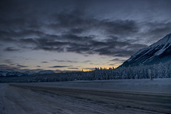 Beauty of the winter roads (Varvara_R) Tags: canmore road winter sky snow canada cold nature weather clouds dawn frost perspective alberta cloudysky sunrise cloudscape darkclouds geotagged