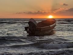 Frenchman's Bay Sunset (Explored) (jmaxtours) Tags: sunset frenchmansbay frenchmansbaysunset stelizabethparishjamaica caribbeanocean caribbean boat fishingboat beach sand surf treasurebeachjamaica treasurebeach