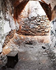Cell with exposed wall and stool (fotophotow) Tags: easternstatepenitentiary philadelphia