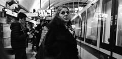 More than some pretty face beside a train... (Baz 120) Tags: candid candidstreet candidportrait city contrast street streetphoto streetcandid streetportrait strangers rome roma ricohgrii europe women monochrome monotone mono noiretblanc bw blackandwhite urban life portrait people provoke italy italia grittystreetphotography faces decisivemoment