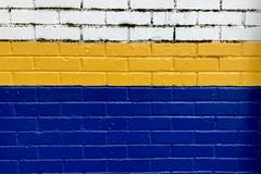 Kwik-Fit (Rhisiart Hincks) Tags: paint paent brick yellow blue white briciau gwyn melyn glas cymru ceredigion aberystwyth kwikfit moger wall balla wal