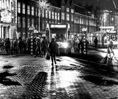 One Evening In Amsterdam (Emil de Jong - Kijklens) Tags: blackandwhite zwartwit amsterdam kijklens people straat light night nacht