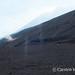 Mini dust devil on slope as colleague arrives