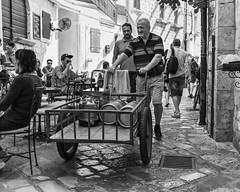 Local man delivering beer kegs in Kotor Old Town (Braca Stefanovic) Tags: bw adriaticsea architecture authentic balkans beer café city cobblestone deliver downtown europe kegs life local man job occupation pedestrian people streetphotography promenade pub real routine scenic wheeler urban vehicle walk wheelcart work braca stefanovic kotor montenegro