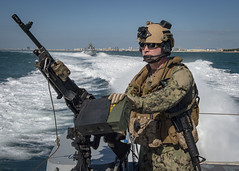 A Sailor stands watch during a presence patrol in the Arabian Gulf, Jan. 6, 2020.