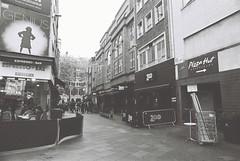 Bear Street (goodfella2459) Tags: nikonf4 afnikkor24mmf28dlens ilfordhp5plus400 35mm blackandwhite film analog city streets london bearstreet buildings bwfp