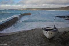 3KB10985a_C (Kernowfile) Tags: cornwall cornish pentax sennencove sennen breakwater rocks sky capecornwall sea waves breakingwaves spray foam sand beach clouds cliffs boat fishingboat slipway