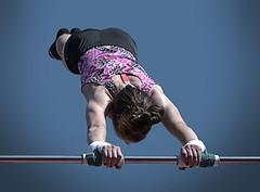 Around & Around (Scott 97006) Tags: girl kid female gymnast highbar strength coordination sport athletic coordinated