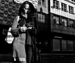 Telephone Banking ! (Neil. Moralee) Tags: neilmoralee street candid woman lady female shadow bank telephone mobile cell lloyds taunton somerset uk black white mono monochrome blackandwhite blackwhite neil moralee bw blackbackground olympus omd em5 bright danger accident