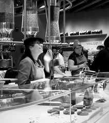 Friendly Service (Demmer S) Tags: customerservice friendly smile friendlyservice interaction communication pleasant smiling facialexpression coffee counter cafe working business coffeeplace inside streetphotography people coffeeshop coffeechain peoplewatching documentary candid citylife person urban coffeecompany city urbanphotography urbanexploration interior indoors coffeedrinker coffeehouse work barista hat apron pastries coffeebar employee bw monochrome blackwhite blackandwhite blackwhitephotos blackwhitephoto