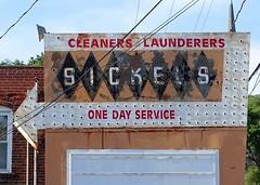 IA, Burlington-Sickels Cleaners Ghost Neon Sign