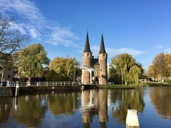 Eastern Gate (sander_sloots) Tags: brick gothic eastern gate oostpoort delft baksteengotiek water reflection trees autumn herfst bomen weerspiegeling dctz90 lumix panasonic draw bridge ophaalbrug brug backsteingotik towers torens architectuur architecture