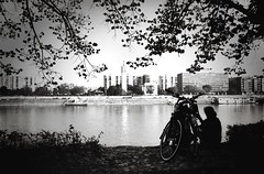 Lady with a bike (Missing Pictures) Tags: panorama woman white black water monochrome bike lady river town hungary mood budapest danube peopleonthestreet utban travel europe eu explore traveling