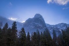 Backlit Sentinel Rock - Yosemite Valley (phonnick) Tags: canon eosr yosemite yosemitenationalpark nationalpark california landscape mountains clouds valley trees fog winter mirrorless