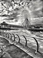 Wintry Blackpool (tubblesnap) Tags: motorola g6 snapseed bracing winter stormy cold waves blustery windy sea foam blackpool pier big wheel black white mono spray chilly drama dramatic