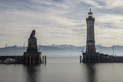 gate to the mountains (crazyhorse_mk) Tags: lindau bodensee lakeconstance lake water harbour lighthouse mountain alps sky clouds