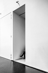 a short story about a lonely leg (ignacy50.pl) Tags: blackandwhite indoor details gallery man leg walls reportage