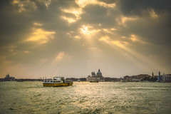 Venetian Light (RobertCross1 (off and on)) Tags: 20mmf17panasonic adriatic em5 europe italia italy omd olympus sanmarco santamariadellasalute veneto venezia venice architecture baroque boat church clouds lagoon landscape medieval mirrorless ship sun sunrays vaporetto water