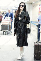 10219242d (sylbd) Tags: he sui at beijing capital international airport china 26 apr 2019 black coat wet look pvc leather vinyl handbag bag by wearing saint laurent yves ysl white boots shoes heels fashion model alone female fulllength personality outabout 80020736