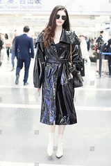 10219242e (sylbd) Tags: he sui at beijing capital international airport china 26 apr 2019 black coat wet look pvc leather vinyl handbag bag by wearing saint laurent yves ysl white boots shoes heels fashion model alone female fulllength personality outabout 80020739