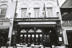 The Imperial (goodfella2459) Tags: nikonf4 afnikkor24mmf28dlens ilfordhp5plus400 35mm blackandwhite film analog london pub building theimperial city bwfp