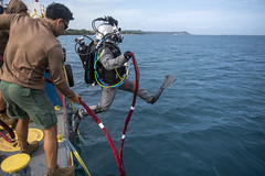 UTC-2 conducts maintenance on piers in Guam.